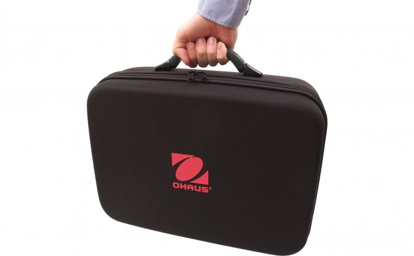 Can the Ohaus Navigator scale be used without removing it from the carrying case?